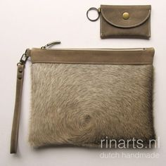 Een persoonlijke favoriet uit mijn Etsy shop https://www.etsy.com/nl/listing/503219317/cow-hair-clutch-leather-zipper-pouch-cow