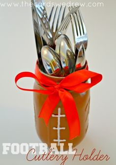Turn a mason jar into a football silverware holder. | 39 Clever Tailgating DIYs To Get You In The Spirit
