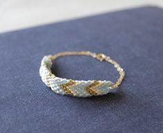 baby blue / gold - woven chevron gold bracelet - last one. $30.00, via Etsy.