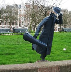 Mysteriously standing in Marnix Park in #Amsterdam, this #bronze #statue is of a #headless #musician.