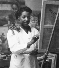 """""""Loïs Mailou Jones painting in her Paris studio"""" (1905 - 1998, American artist who painted and influenced others during the Harlem Renaissance and beyond)"""