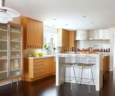 Light brown and white cabinets keep this modern kitchen from looking cold. See the rest of this kitchen: http://www.bhg.com/kitchen/styles/modern/a-midcentury-modern-makeover/?socsrc=bhgpin021813modernkitchen