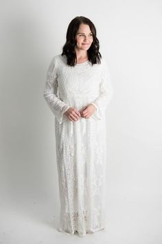 "Fully lined lace temple dress. Model is 5'7"", size 8/9 in pants, wears medium tops and is wearing the S/M. S/M fits 0-8 comfortably M/L fits 8-14 comfortably"