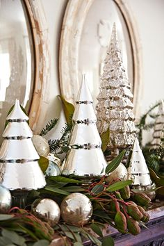 Mercury glass Christmas trees adds a unique shine to this holiday mantel. Decoration Christmas, Christmas Mantels, Christmas Vignette, Silver Christmas, Noel Christmas, Christmas Christmas, Vintage Christmas, Christmas Greenery, Christmas Villages