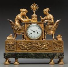 A Charles X Gilt Bronze And Marble Figural Clock
