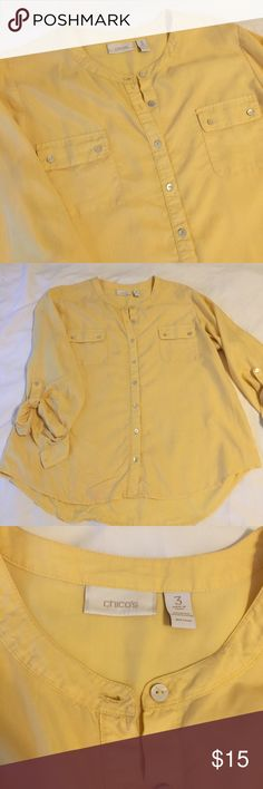 Chico's size 3. XL 16 yellow silky button up. Chico's size 3. XL 16 yellow silky button up.  Bust measures approximately 24 1/2. Armpit to hem measures approximately 15 inches.  Small stain at the bottom. Hardly noticeable. Chico's Tops Button Down Shirts