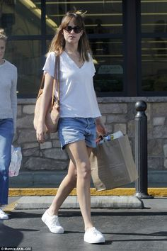 """Step out like Dakota in Eytys sneakers Click """"Visit"""" to buy #DailyMail"""