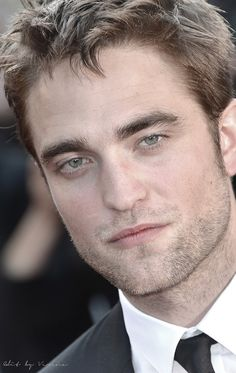 Why have I never noticed the cute little freckles across the bridge of Rob's nose???