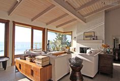 Image from http://photo.interiorpik.com/uploads/2013/8/9/effect-picture-of-simple-european-style-beach-house-living-room-decoration.jpg.