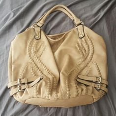 SALE Big Buddha Boho Bag Purchased from a posher while back. Gorgeous bag. Used 2-3 times. Still in immaculate condition as when was bought. Bag is a gorgeous taupe/tan like color. No flaws from what I see. Cute leopard print satin material liner. 2 side pockets on inside and one zippered pocket inside. One zippered hidden pocket on back of bag. Gorgeous bag! Do not pass up! **price is firm** >bundle and save!< Big Buddha Bags Hobos