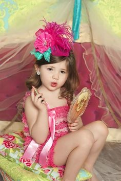 This picture reminds me of my little girl...she pinches my makeup all the time!