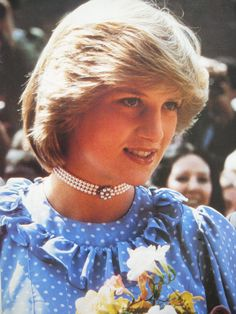 Princess Diana necklace and iconic hairstyle