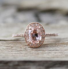 1.0 Ct.  Peach Pink Cushion Sapphire & Diamond Halo Engagement Ring in 14K Gold via Etsy
