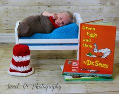 Newborn boy photography , cat in the hat , wooden bed, books