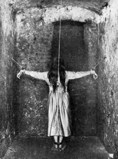 A patient in a mental institution in France in 1900.
