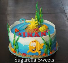 Bubble guppies cake. Perfect for under the see kids birthday cake. Done by Sugarella Sweets. For more ideas go to www.SugarellaSweets.com
