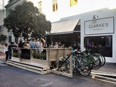 Clarkes-Parklet (2048×1536)  Explanation: Parklets are small urban spaces (usually regular vehicular parking spots in strategically place high pedestrian zones) which can be considered parks. Their intention is to reclaim green and public spaces for the citizens of cities.
