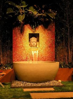 Eastern inspired wall fountain. Love the warm colors and huge basin.