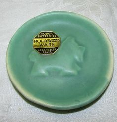 """Tudor Potteries small plate or coaster measuring 3"""" across with an embossed dog"""