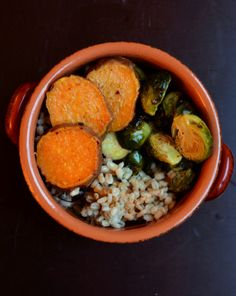 Warm Barley Bowl with Roasted Brussels, Sweet Potatoes and a Coconut Curry Dressing
