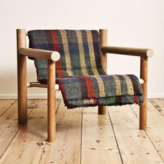 Truly diggin' this wooden armchair by Max Lamb...it's basically dowels and slats, and you can personalize it any way you'd like...a folded blanket (shown), or cushions, or au natural...