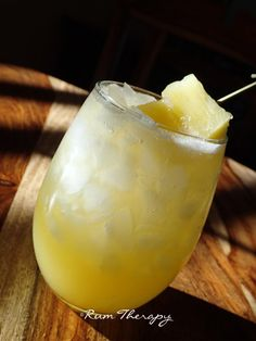 Pineapple-Rum-Punch: 1 c. ginger ale; 1 c. pineapple juice; 1/3 c. coconut rum (we used Blue Chair Bay); cracked ice; pineapple chunks for garnish (fresh if at all possible).