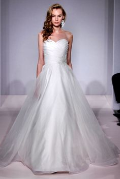 I think I saw this on say yes to the dress and it was so flattering and pretty.michelle roth a line organza