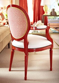 An antique chair was reupholstered and painted a glossy red. - Traditional Home ® / Photo: Werner Straube / Design: Julie Massucco Kleiner