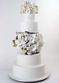 Modern wedding cake with orchids, peonies, and roses separating tiers - Ron Ben-Israel Cakes - Reverie Gallery Wedding Blog