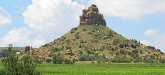 """THABA BASIU - The name means """"mountain at night"""". According to legend, what was a hill in the daytime became a mountain at night. Thaba-Bosiu is an important historical site — the survival of the Basotho as a nation in the 19th century depended on Moshoesoe's ability to defend his capital, and Thaba-Bosiu was never taken."""