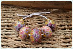 https://flic.kr/p/ttVoP2   baticbeads yellowviolet   I like to call these kind of beads baticbeads. The lines and patterns appear as a reaction of the glass that is used. It's a slow process of carefully layering dots , melting them in and slowly watch the glass performing it's magic. Even though I already made a lot of beads this way, there's always an element of surprise in how the used colours appear.