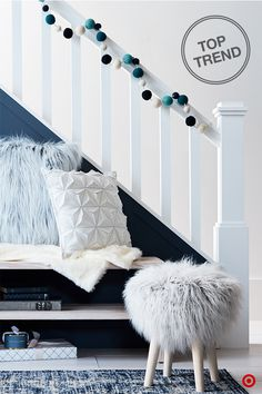 Forget the winter blues and elevate your entryway with shades of this cool hue. Big on style, faux fur keeps you cozy and warm during the chilly winter months. Find this furry trend on decorative pillows, blankets and stools. Sprinkle in other textural pieces, like this geo-faceted pillow and fun pom pom garland for a whimsical holiday look.