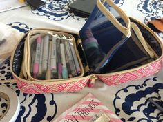 Cosmetic case use for journaling on the go - with a section for pens, tape, scissors, and even some bits of ephemera.