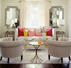 Pretty: the colourful photos, I like the symmetrical chairs and mirrors - Sköna hem
