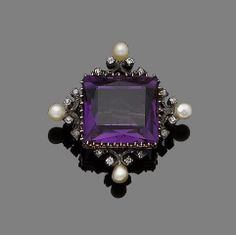 An amethyst, seed pearl and diamond brooch Centrally-set with a mixed-cut amethyst, within a lozenge-shaped scrolling frame set with old brilliant and rose-cut diamonds, highlighted with seed pearls, length 3.8cm