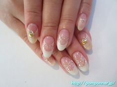 ホワイトとシェルを使ったダブルフレンチネイル  Double French using the shell is cool nail. Make a double French in the shell and white, was caught in the line of lame silver border. Make a reverse French lame beige, I decorated with studs of the shell and stone nails other.