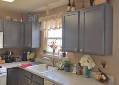 We love this kitchen transformation! Maria Manochio refinished her kitchen cabinets using General Finishes Driftwood Milk Paint and High Performance Top Coat Satin.