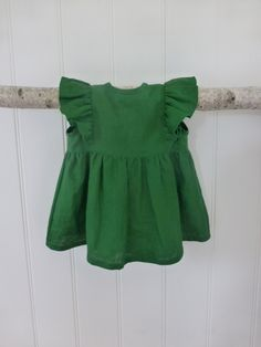 A twist on our Ashling tunic - made out of  100% linen in the most beautiful shade of green.Slightly longer than our Ashling tunic, with the same billowy fit and simple tie closure at the back.Sent via registered post with a signature on delivery