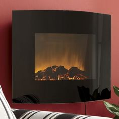 Curved Black Glass Wall Fireplace with Remote from Seventh Avenue ®
