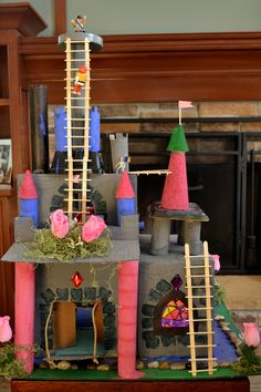 cardboard castle.  Great inspiration - I love the ladders, colorful foam cones, block print around doors & windows, gems, stained glass...