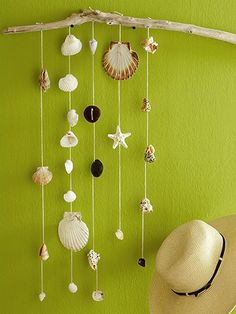 This would be cute in our bathroom.  Hanging Shell Wall Art:   Create wall art from natural finds. Drill several holes in a long piece of driftwood. Pull twine, approximately 30 inches long each, through the holes and tie at the top. If shells have natural holes, pull twine through them. Tie knots to hold shells in place. If necessary, drill through shells to create holes.