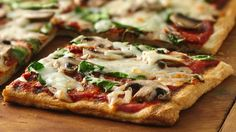 Grilled pizza is easier than you think, and  this spinach and mushroom veggie pizza recipe is a hearty and delicious one to try.