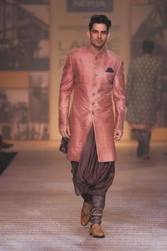 Onion Peach with Brown: You are the groom, and it behooves you to make no elementary choices. Hog the limelight by togging up in this natty, unconventional pair, and let your styling effort receive its full due.