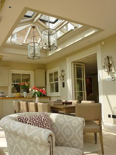 Beautiful rectangular shaped roof lantern with an aperture of 3200mm x 2100mm used to define a dining area in a kitchen.