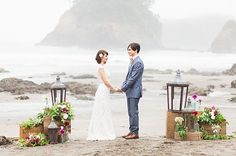 morning beach elopement. Love the use of the crates, lanterns and flowers as a framing altar.
