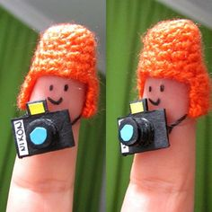 orange finger peoples with cameras