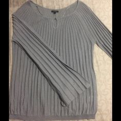 Grey shimmery knitted blouse It's a very pretty shimmery grey blouse great to wear with jeans or dress pants very comfortable.  It has a flare sleeves. Apt. 9 Tops Blouses