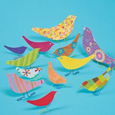 Scrapbook paper birds--a flock of these in pastel colors would be adorable on a shelf for Easter!