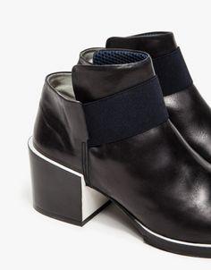 black pointed toe booties by Wood Wood