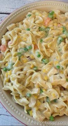 2 cups uncooked egg noodles 2 cups cubed cooked chicken 1 package {16oz.} frozen peas, carrots, beans and corn 1 cup milk 1 can Cream of Chicken Soup 1 Can Cream of Mushroom Soup 1/2 tsp. Salt 1/2 tsp. Pepper 1/2 cup Chopped onion 2 TBSP. Melted Butter 1/2 tsp. Garlic Salt 1/2 tsp. Italian Seasoning Cook noodles combine the remaining ingredients. Put in greased 8 inch cake pan Cover and bake 350 for 30 minutes. Uncover and bake 10-15